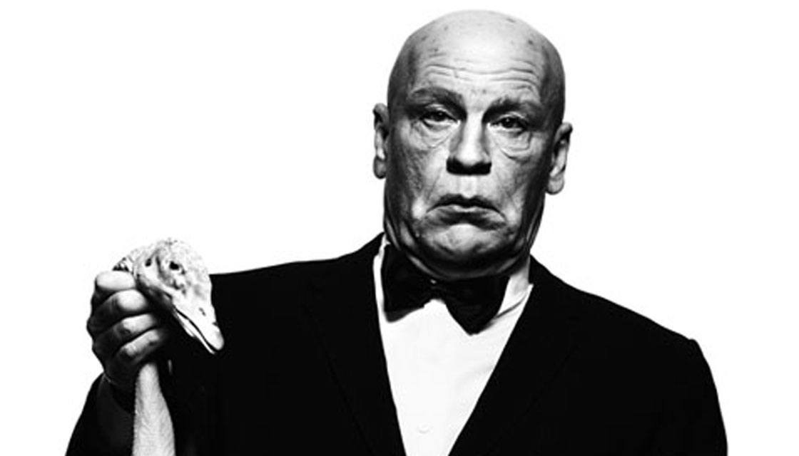 John Malkovich as Alfred Hitchcoc